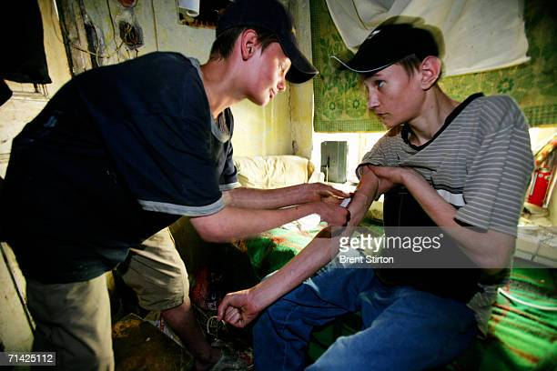 Streetkids shoot up in a condemn house on August 21 2005 in Odessa Ukraine They are using a needle and syringe that were lying on the floor of the...