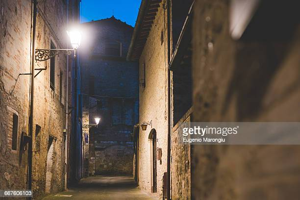 Streetlamps and alley at dusk, Colle di Val dElsa, Siena, Italy