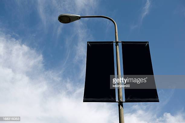 streetlight banner - commercial sign stock pictures, royalty-free photos & images