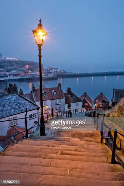 streetlight near 199 steps against nort sea, whitby, uk - whitby north yorkshire england stock pictures, royalty-free photos & images
