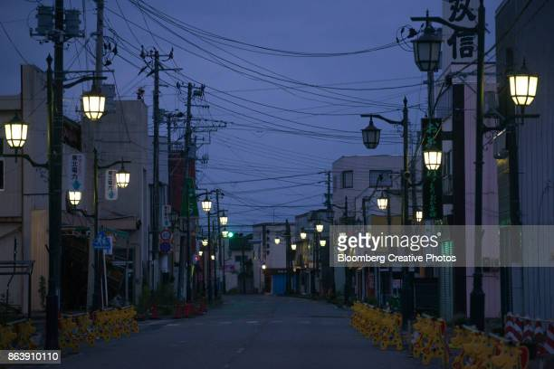 streetlights at night in namie, fukushima prefecture, japan - empty streets stock pictures, royalty-free photos & images