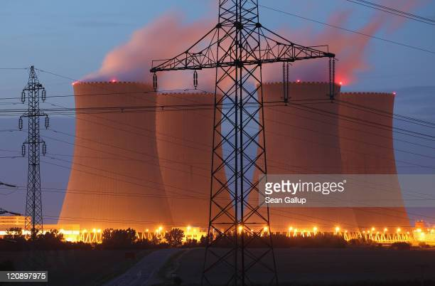 Streetlights illuminate the four cooling towers of the Temelin nuclear power plant on August 11 2011 near Temelin Czech Republic CEZ the Czech...