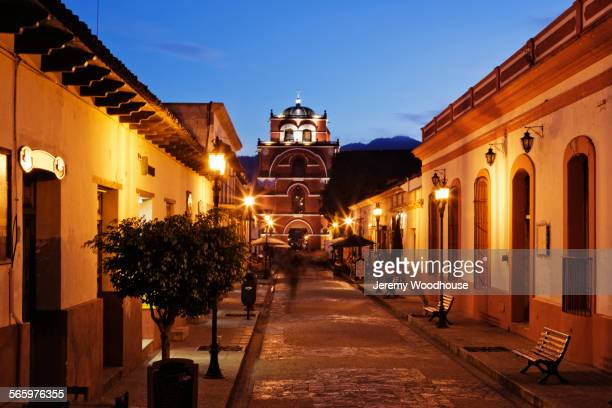 Streetlights outside houses on village street, San Cristobal de las Casas, Chiapas, Mexico