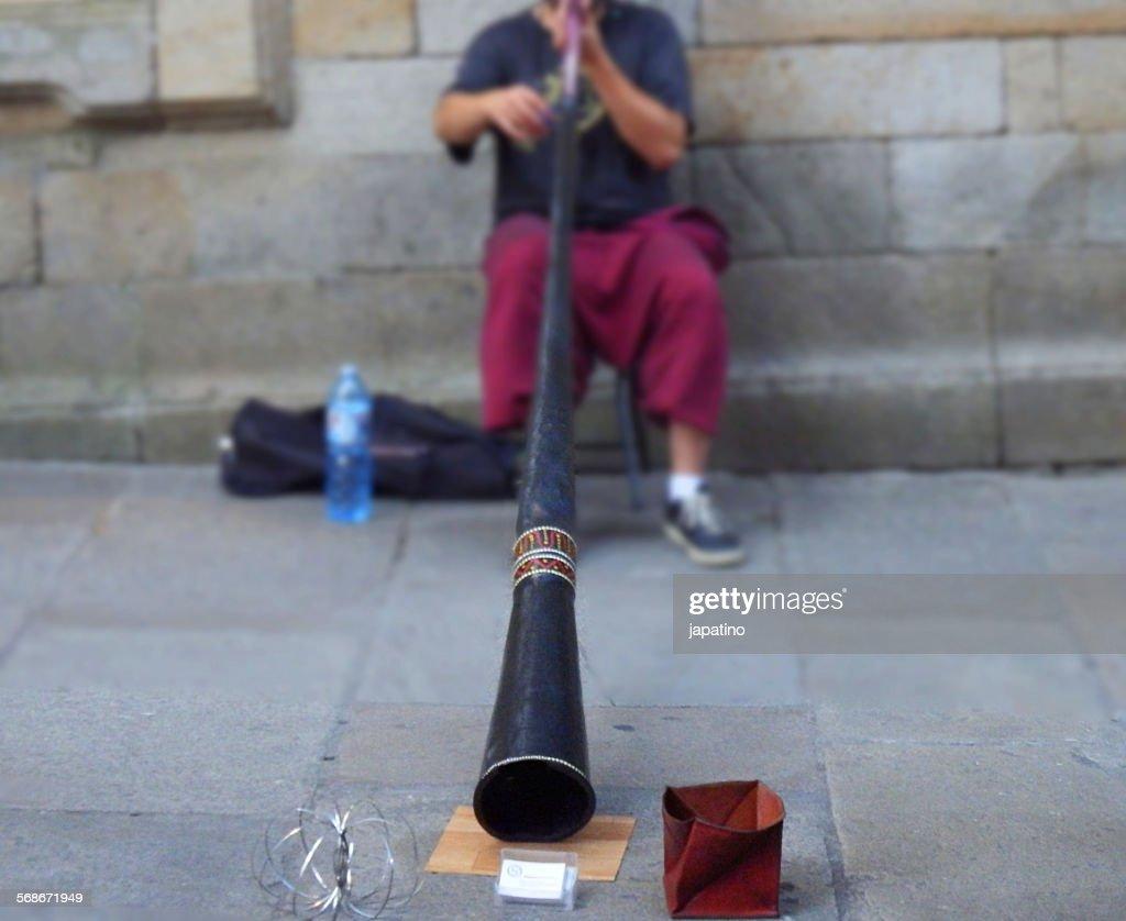 Streetmusician didgeridoo : Stock Photo