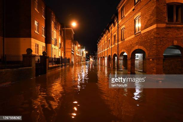 Streets alongside the River Ouse in York flood as rain and recent melting snow raise river levels on January 21, 2021 in York, England. Storm...
