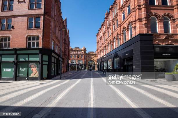 Streets are deserted in Leeds city centre, West Yorkshire on April 14 as life in Britain continues during the nationwide lockdown to combat the novel...