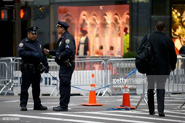 Streets are pedestrianised due to security measures as New York City Police Department officers stand guard in front of the Trump Tower where big...