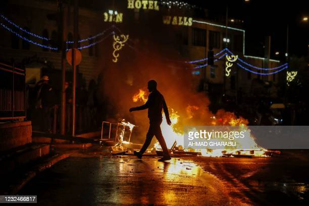 Streets are set ablaze as members of the Israeli security forces deploy during clashes with Palestinian protesters outside the Damascus Gate in...