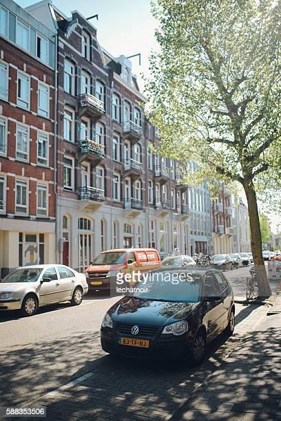 streets in amsterdam - parkplatz stock-fotos und bilder