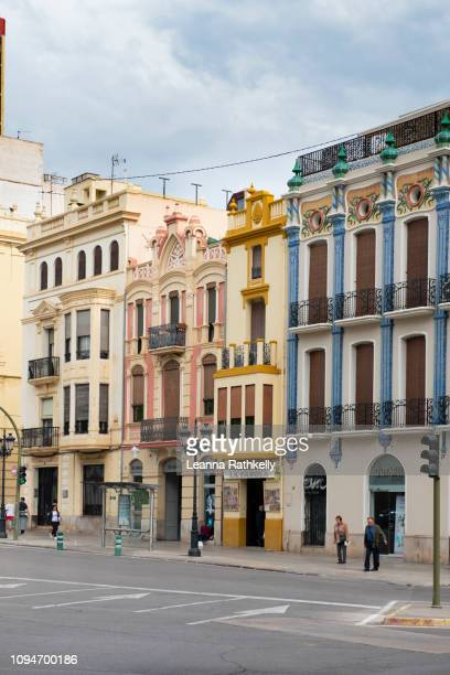 streets in castellon de la plana are narrow and well travelled. - castellon province stock pictures, royalty-free photos & images