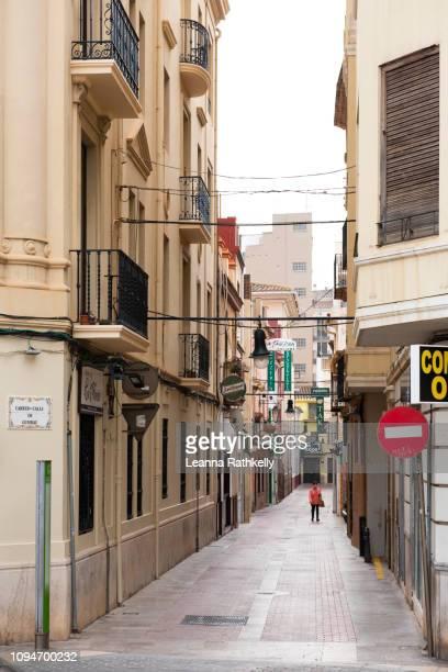 streets in castellon de la plana are narrow and well travelled. - castellon de la plana stock photos and pictures