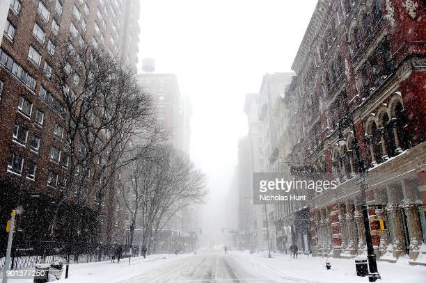 Streets in Soho are covered in snow during a massive winter storm on January 4 2018 in New York City As a major winter storm moves up the Northeast...