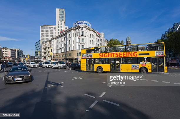 Streets Kurfuerstendamm corner Joachimstaler Strasse with new high rise building Zoofenster with luxury hotel Waldorf Astoria a sightseeing bus and...