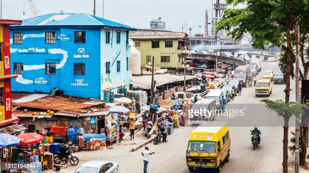 """streets of african city - lagos, nigeria - """"peeter viisimaa"""" or peeterv stock pictures, royalty-free photos & images"""