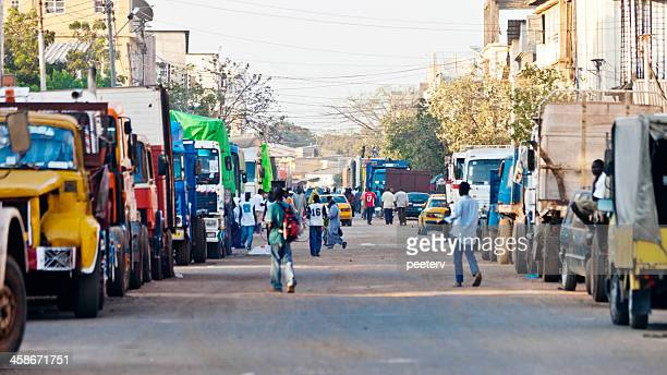 streets of african town. - gambia stock photos and pictures