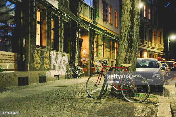 streets of berlin at night - friedrichshain stock photos and pictures