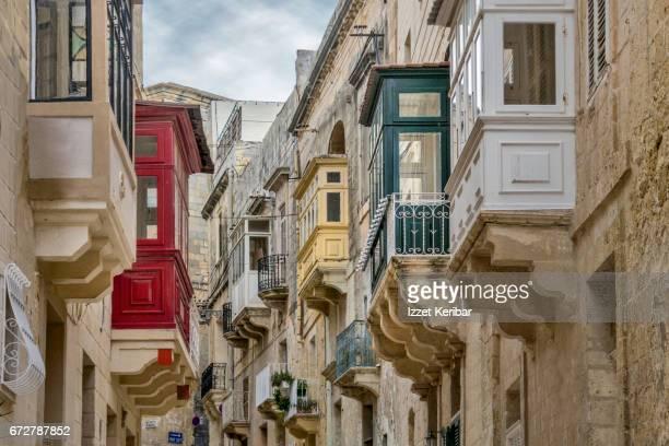 Streets of Birgu and colorful baywindows  (Vittoriosa) near Valletta, Malta