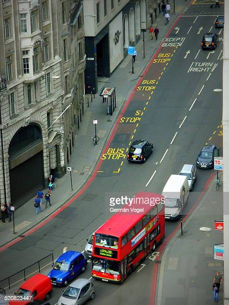 Streets of central London by Bishopsgate including a doubledecker red bus