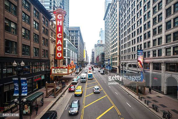 streets of chicago downtown. - chicago theater stock pictures, royalty-free photos & images