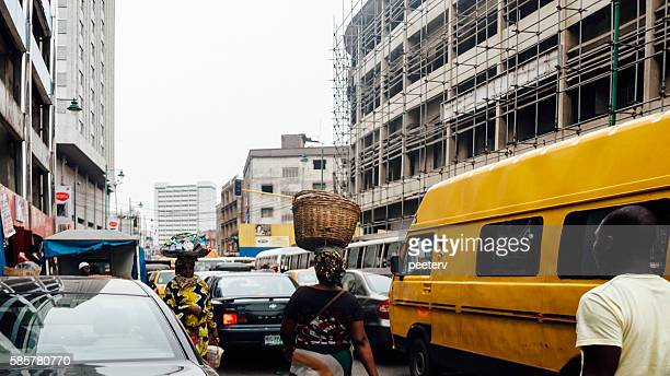 streets of downtown lagosa, nigeria. - lagos stock photos and pictures