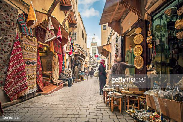 streets of fez - multi colored hat stock pictures, royalty-free photos & images