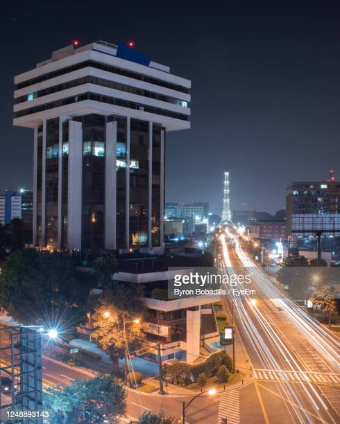 streets of guatemala with reformador tower - guatemala city stock pictures, royalty-free photos & images