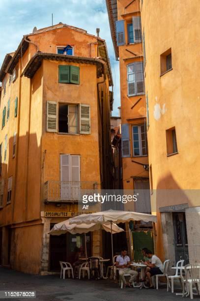 streets of historic town grasse, grasse, provence-alpes-côte d'azur, france - alpes de haute provence stock photos and pictures