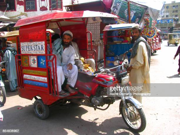 streets of karachi - pakistani culture stock photos and pictures