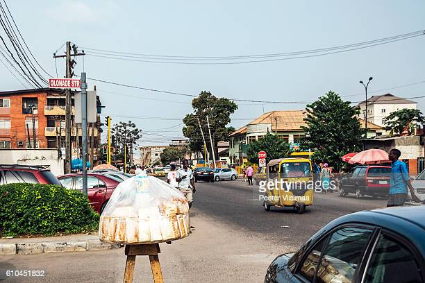 streets of lagos, nigeria. - nigerian food stock pictures, royalty-free photos & images