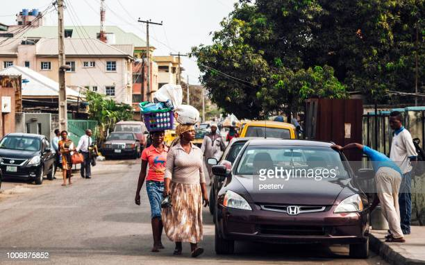streets of lagos, nigeria, west africa - nigerian men stock photos and pictures