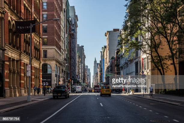 streets of soho nyc - broadway manhattan stock photos and pictures