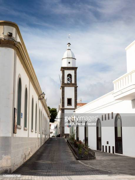 streets of the city of arrecife with his building of the town hall and church, in lanzarote , canary islands, spain. - arrecife stock photos and pictures