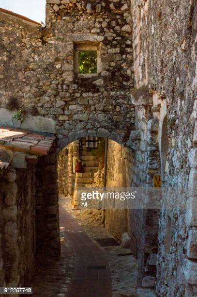 streets of the medieval village of eze, eze, french riviera, france - alpes de haute provence stock photos and pictures