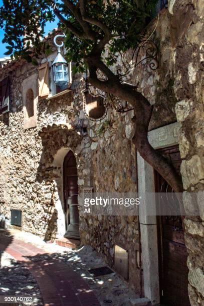 streets of the medieval village of eze, eze, french riviera, france - eze village photos et images de collection