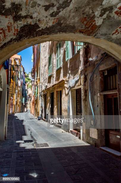 streets, passageways and terraces of menton, french riviera, france - alpes de haute provence stock photos and pictures