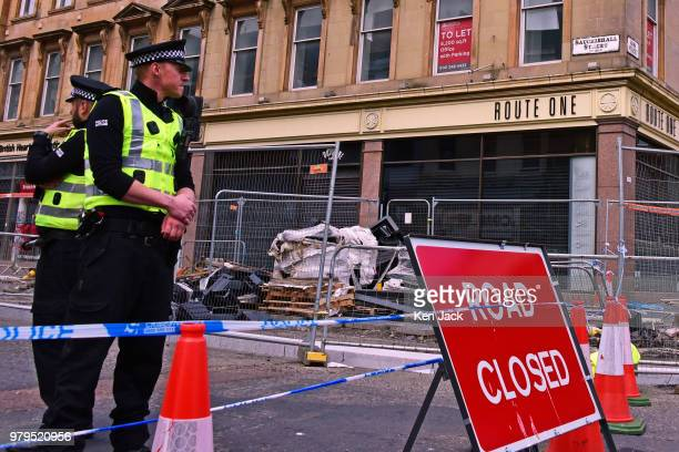 Streets remain cordoned off around the Glasgow School of Art Mackintosh building which was completly burned out in a major fire still carry...