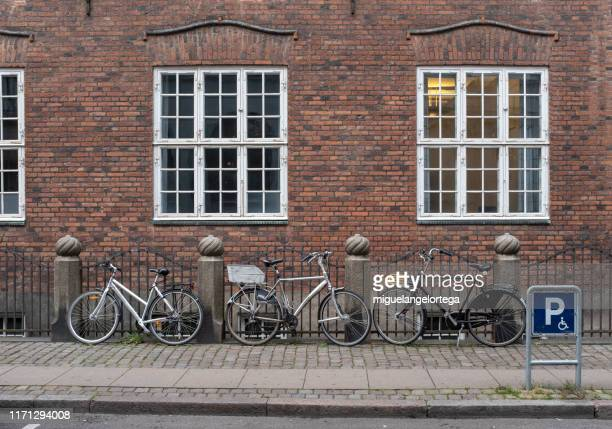 streets with bicycles - danish culture stock pictures, royalty-free photos & images
