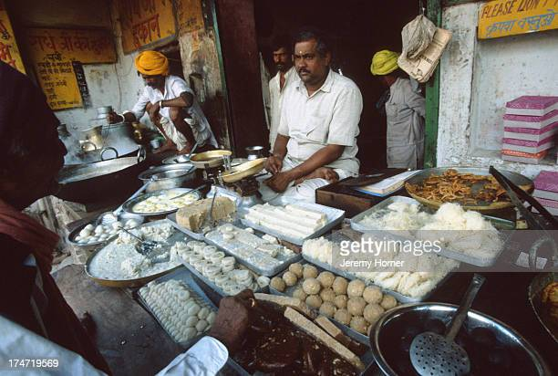 A streetside stall selling milk sweets in Ajmer Rajasthan