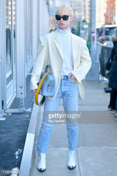 A streetstyle shot of guests arriving outside Spring Studios during New York Fashion Week The Shows at Spring Studios on February 13 2019 in New York...