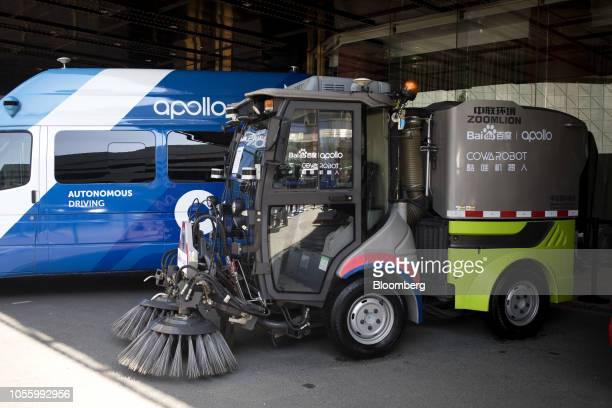 A streetsweeping truck featuring the logos of Baidu Inc's Apollo autonomous driving platform Zoomlion Heavy Industry Science and Technology Co and...