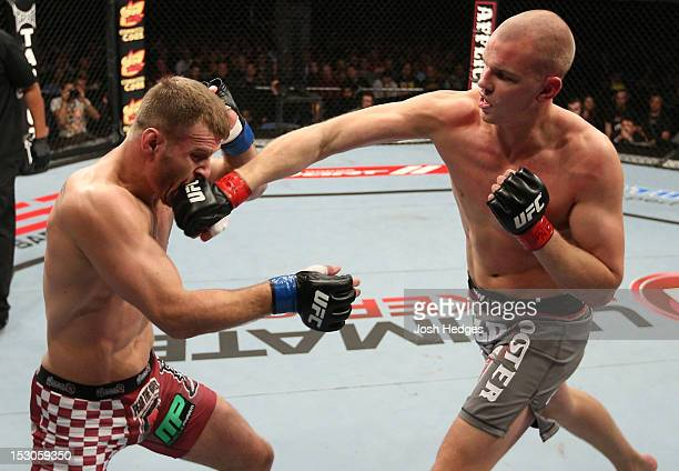 Strefan Struve punches Stipe Miocic during their heavyweight fight at the UFC on Fuel TV event at Capital FM Arena on September 29 2012 in Nottingham...