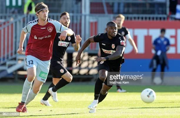 Streli Mamba of Cottbus battles for the ball with Hendrik Ostermann of Flensburg during the Third League Playoff Leg 1 match between SC Weiche...