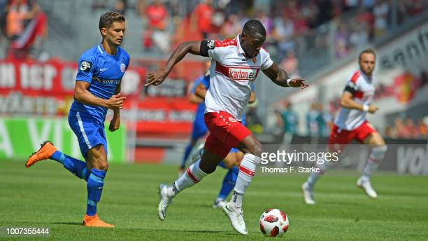 Streli Mamba of Cottbus runs with the ball during the 3. Liga match between FC Energie Cottbus and F.C. Hansa Rostock at Stadion der Freundschaft on...