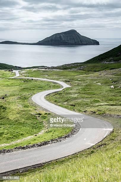Stremnoy island, Faroe Islands, Denmark. Bending road.