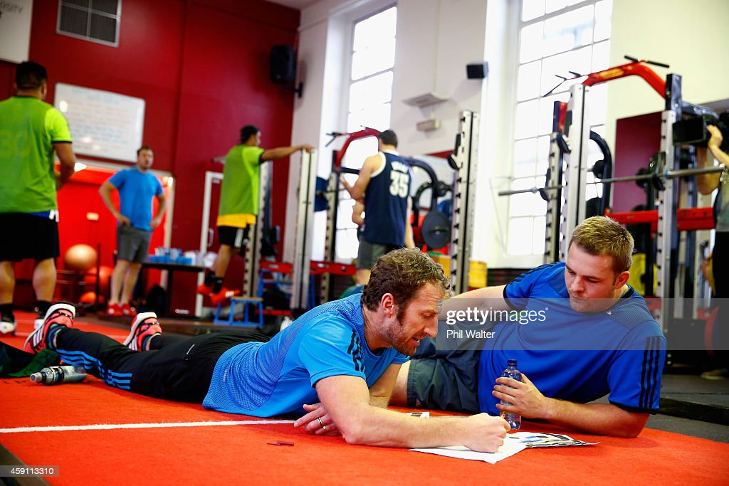 Strength and Conditioning coach Nic Gill (L) speaks with Sam Cane of the All Blacks during a New Zealand All Blacks Gym session at the Cardiff University Strength and Conditioning Centre on November 17, 2014 in Cardiff, Wales.