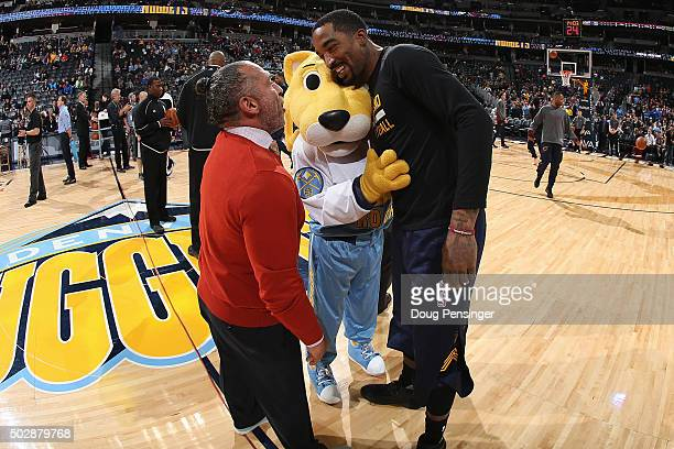 Strength and conditioning coach Steve Hess and Rocky the mascot greet JR Smith of the Cleveland Cavaliers prior the game at Pepsi Center on December...