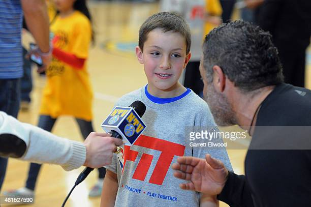 Strength and Conditioning Coach Steve Hess of the Denver Nuggets interviews a 4th grader from Lowry Elementary during a NBA Team Fit event on January...