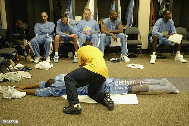 Strength and conditioning coach Steve Hess works on Marcus Camby as the Denver Nuggets prepare for a game against the Memphis Grizzlies on February...