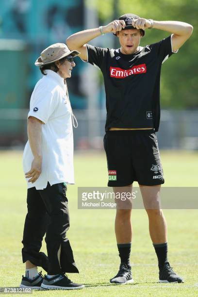 Strength and conditioning consultant Bohdan Babijczuk takes Darcy Moore of the Magpies through his paces during a Collingwood Magpies AFL training...