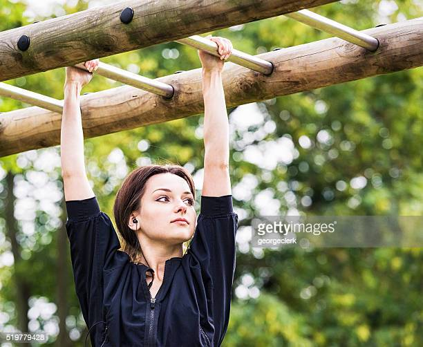 strength and fitness training on outdoor monkey-bars - conquering adversity stock pictures, royalty-free photos & images